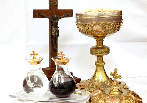 Holy Communion (the chalice and vials of water and wine)  and Jesus on the Cross.